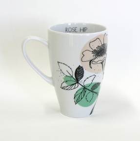 tea mug with rose hip decoration by kristoff fine porcelain
