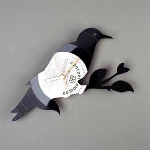 bird wall clock made of vinyl record